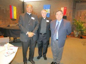 Bishop Martin Holley, with Manuel Aliaga and Bishop Rozanski, 16 October 2013 - Photo: Migrantes Hoy, CELAM, Latin American Bishops Council